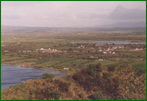 Across the southern shore of Lake Inchiquin lies the picturesque village of Corofin nestling between Lake Atedaun (southern side) and Lake Inchiquin. This photograph was also taken from Clifden Hill.